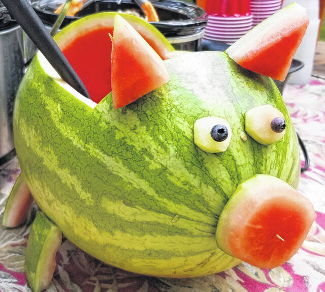 Joining the picnic was a cut-out watermelon bowl, filled with fruit salad, and created in the shape of a pig with feet, eyes, ears and a snout.