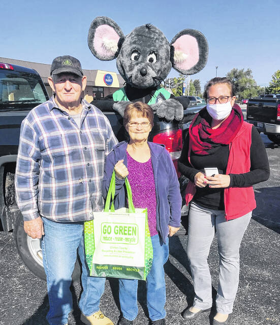 """Jim and Ruth Everhart of Sabina were """"busted"""" by Buster the Mouse last year as part of the """"Get Caught Recycling"""" campaign."""