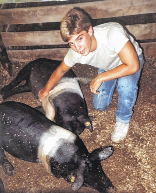 As a member of the New Antioch Hustlers 4-H Club, young Mike Carey took hog projects to the Clinton County Fair.