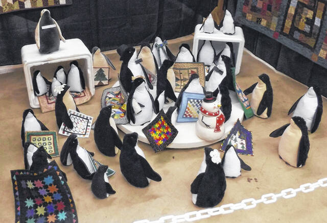 One quilt display space contained this eye-catching colony of penguins. A sign indicated the penguins will all be donated to Shriners Hospital after the quilt show.