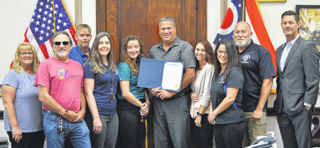September is Recovery Month in Clinton County in accord with a Wednesday proclamation by the Board of Clinton County Commissioners. The observance focuses on recovering from drug or alcohol addiction. The proclamation states the more that individuals, families and friends understand addiction, the less stigma it carries which can help a person feel more comfortable seeking help. Joining county commissioners in the photo are staff with the Clinton County Common Pleas Court's Community Supervision Department. From left are Commissioner Brenda Woods, James Crafton, Jeff Lemmons, Jessica Harrington, Brittany Patterson, Commissioner Mike McCarty, Brenda Harris, Amanda Gordley, Chief Probation Officer Duane Weyand, and Commissioner Kerry Steed.
