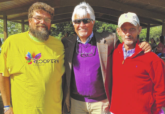 """Judge John W. """"Tim"""" Rudduck, center, with Jason Hollingsworth and Chris Bricker, both of whom are active in the recovery community and help others through recovery. Rudduck presides over the You-Turn Recovery Docket (local drug court)."""