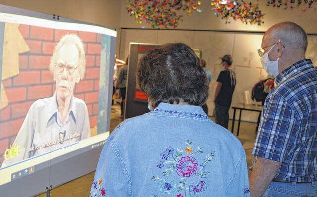 The exhibit includes a video recording that features Larry Gara and his wife Lenna Mae when they were interviewed on a Cincinnati public television program. Watching the program in the foreground are Ruth and Neil Snarr.