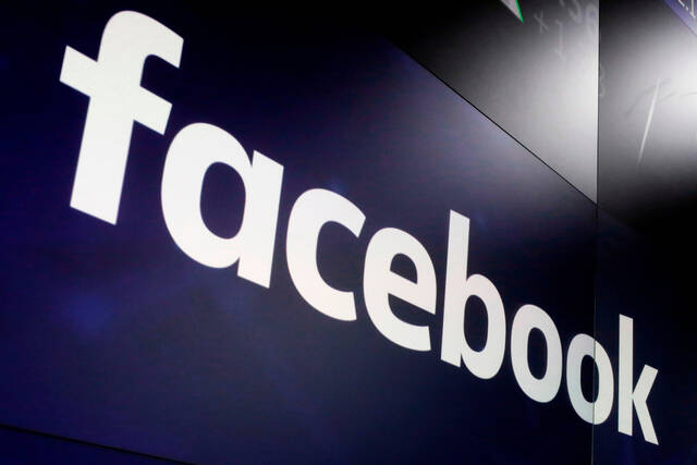 FILE - In this March 29, 2018, file photo, the logo for Facebook appears on screens at the Nasdaq MarketSite in New York's Times Square. Facebook prematurely turned off safeguards designed to thwart misinformation and rabble rousing after Joe Biden defeated Donald Trump in the 2020 elections in a moneymaking move that a company whistleblower alleges contributed to the deadly Jan. 6, 2021, invasion of the U.S. Capitol. (AP Photo/Richard Drew, File)