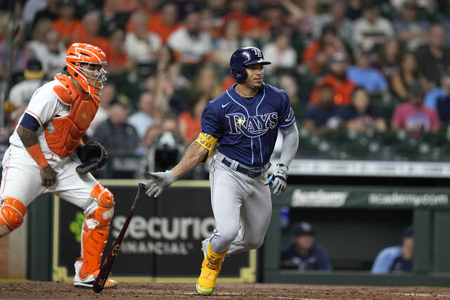 Tampa Bay Rays' Wander Franco, right, hits into a force out as Houston Astros catcher Martin Maldonado watches during the fourth inning of a baseball game Thursday, Sept. 30, 2021, in Houston. (AP Photo/David J. Phillip)