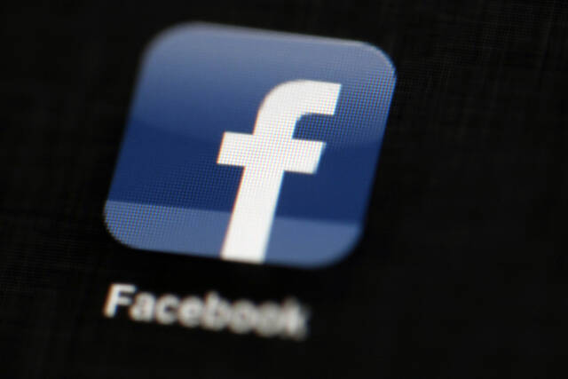 FILE - In this May 16, 2012, file photo, the Facebook logo is displayed on an iPad in Philadelphia. (AP Photo/Matt Rourke, File)