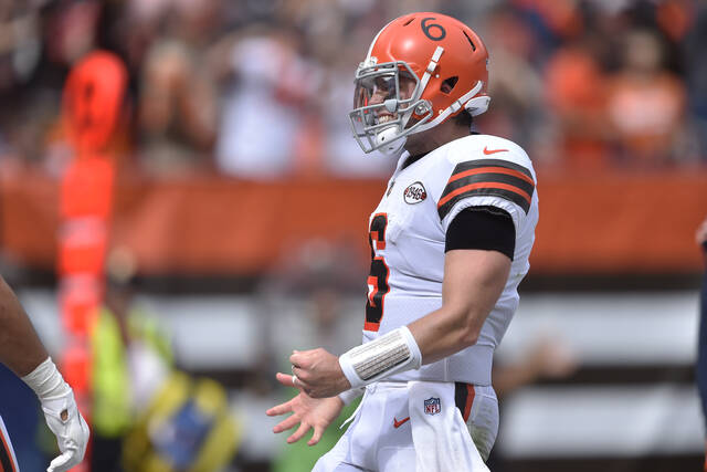 Cleveland Browns quarterback Baker Mayfield (6) celebrates a 13-yard touchdown pass to tight end Austin Hooper during the first half of an NFL football game against the Chicago Bears, Sunday, Sept. 26, 2021, in Cleveland. (AP Photo/David Richard)