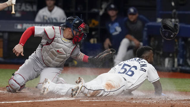 Tampa Bay Rays' Randy Arozarena (56) slides past Boston Red Sox catcher Christian Vazquez, left, as he steals home during the seventh inning of Game 1 of a baseball American League Division Series, Thursday, Oct. 7, 2021, in St. Petersburg, Fla. (AP Photo/Steve Helber)