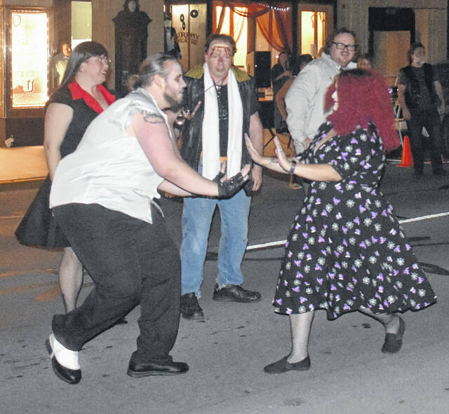 """The unconventional conventionists gathered on Main Street in front of the Murphy Theatre to the Time Warp, again, before the annual October screening of """"The Rocky Horror Picture Show"""" on Friday."""