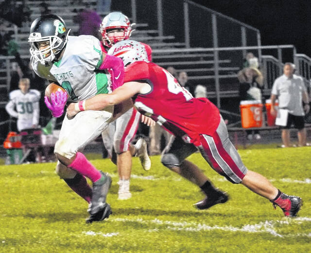 East Clinton's Adrian Baker (42) brings down a Fayetteville ball carrier during last week's game.