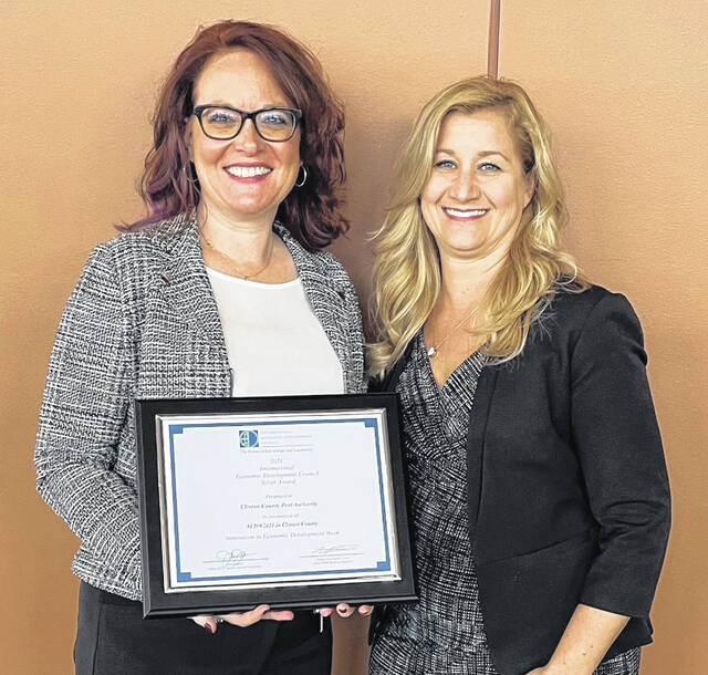 From left are the Clinton County Port Authority's Ruth Brindle and Jennifer Klus, holding the IEDC award.
