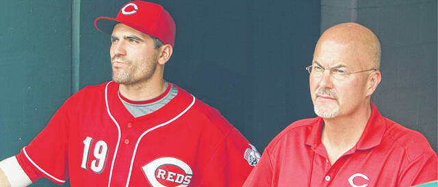 Dr. Kremchek, shown with Cincinnati Reds' star Joey Votto, serves as the Reds' medical director.