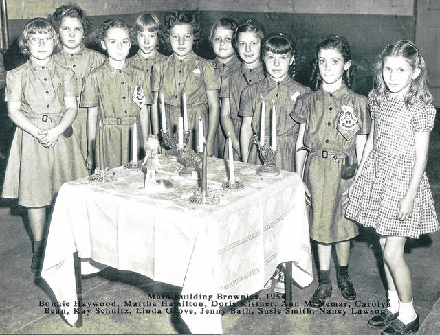 """""""Main Building Brownies"""" in 1954 included Bonnie Haywood, Martha Hamilton, Doris Kistner, Ann McNemar, Carolyn Bean, Kay Schultz, Linda Grove, Jenny Bath, Susie Smith, and Nancy Lawson. Can you tell us more? Share it at info@wnewsj.com. The photo is courtesy of the Clinton County Historical Society. Like this image? Reproduction copies of this photo are available by calling the History Center. For more info, visit www.clintoncountyhistory.org; follow them on Facebook @ClintonCountyHistory; or call 937-382-4684."""