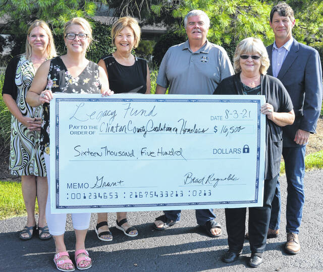 The Clinton County LEGACY Fund Grant Committee awarded $16,500 to the Clinton County Coalition on Homelessness to help fund a professional consultant to build a coordinated community plan to prevent and end homelessness in Clinton County. The local initiative has already begun, and the homelessness consultant hired is Tom Albanese. From left holding the over-size check are Amber Taylor and Denise Stryker both with the coalition; and from left in the back are grant committee members Michelle Morrison, Janet Dixon, Tony Long and Kerry Steed. Not pictured is committee member Joe Hete.