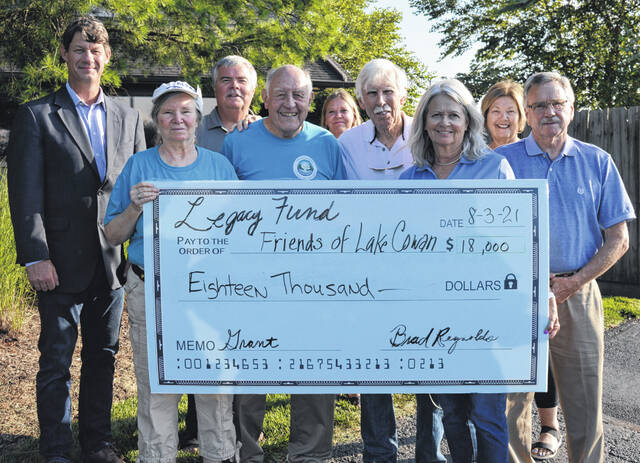 The Clinton County LEGACY Fund Grant Committee awarded $18,000 to the Friends of Cowan Lake to build two replacement bridges on the Emerald Woods Trail, to address a safety hazard. In the front row from left are Gwen Marshall, David Rosekrans, Bill Schieman, Judy Hearn and Wade Hall all with the Friends of Cowan Lake; and in the back from left are are grant committee members Kerry Steed, Tony Long, Michelle Morrison and Janet Dixon. Not pictured is committee member Joe Hete.
