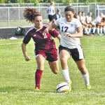 Dogs overwhelm Rossford, 7-0