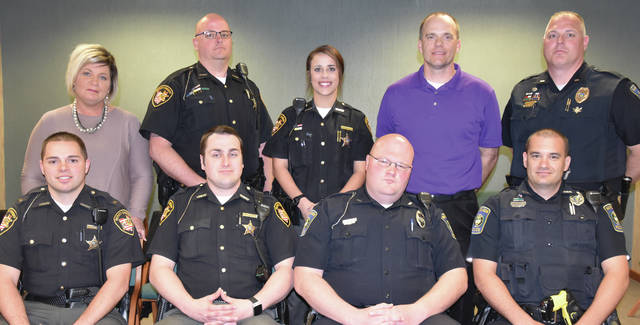 Spring 2017 CIT participants from Fulton and Henry counties. Front row, from left: Henry County Sheriff Department Sgt. Marc Ruskey and Deputy Nick Rasey, and Napoleon Police Department Patrolmen Pat Lannan and Nick Evanoff. Back row, from left: CIT instructor Brenda Byers with Recovery Services of Northwest Ohio, Fulton County Sheriff Department Deputies Chad Hayward and Alexa Schaffner, Fulton County probation officer Shane Chamberlain, and CIT instructor Lt. Dave Mack with the Napoleon Police Department.