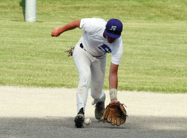 Swanton shortstop Roman Epley fields his position and throws out a Holgate base runner during Thursday's game.