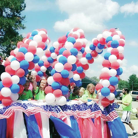 A patriotic float joined the parade at a previous Delta Chicken Festival.