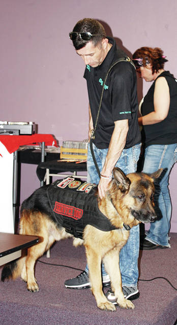 Battle Buddy Foundation creator Kenneth Bass and his dog, Atlas, will attend this year's poker run.