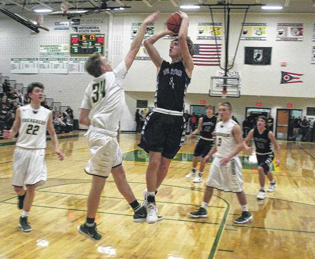 Josh Vance of Swanton scores in a game at Evergreen Friday. Despite holding a lead for much of the game, the Bulldogs fell to the Vikings 48-40.