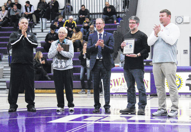 The newest members of the Swanton Local Schools Distinguished Alumni Hall of Fame, Sesario Duran and Steven Haller, were recognized during halftime of the varsity basketball last Monday. Pictured from left, are Hall of Fame committee member Mickey Avalos, Duran, Swanton Superintendent Chris Lake, Haller, and committee member Ryan Pawlowicz.