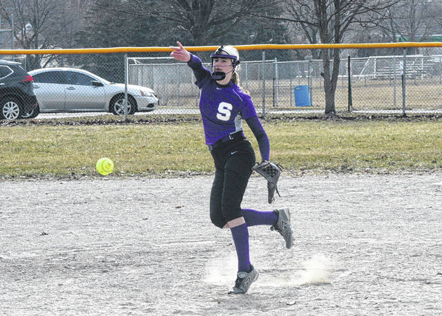 Swanton pitcher Olivia Bergman tosses one in the first game of a doubleheader with Toledo Woodward Saturday. She got the win in the circle in game one, while twin sister Alexis Bergman picked up the win in the second game.