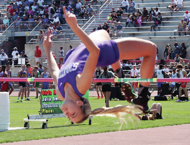 Julia Smith of Swanton clears the bar at the state meet last spring. She holds the school record in the high jump.