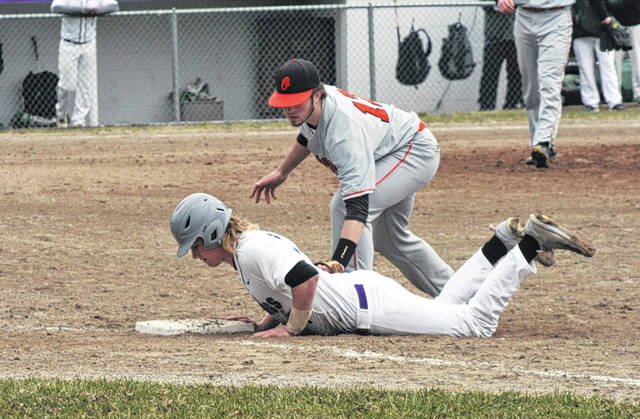 Swanton's Roman Epley dives back to first to avoid being picked off Saturday against Otsego. He led the Bulldog offense, going 2 for 2 with a walk and an RBI.