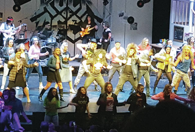 "Swanton High School presented ""Rock of Ages"" to enthusiastic audiences Friday, Saturday, and Sunday in the auditorium. ""Rock of Ages"" is the story of a small town girl and big city boy who fall in love while chasing their dreams of becoming a rock star in Los Angeles in the 1980s. The musical included favorites such as ""Don't Stop Believin',"" ""We're Not Gonna Take It,"" ""Dead or Alive,"" and ""Hit Me With Your Best Shot."""