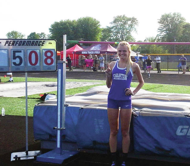 Swanton's Julia Smith won the regional championship in the high jump by clearing a record 5-8.
