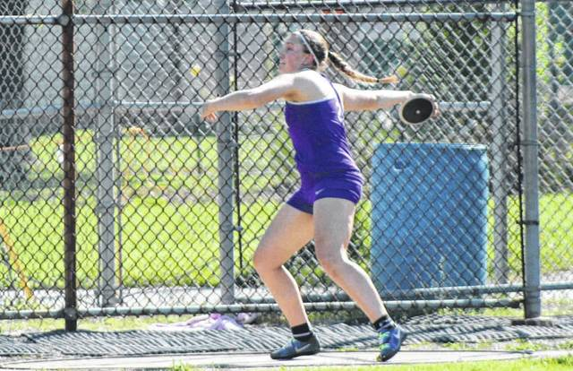Sidney Taylor of Swanton with a throw in the discus Friday during the regional meet in Tiffin. After finishing second in the shot put two days earlier, she was victorious in the discus.