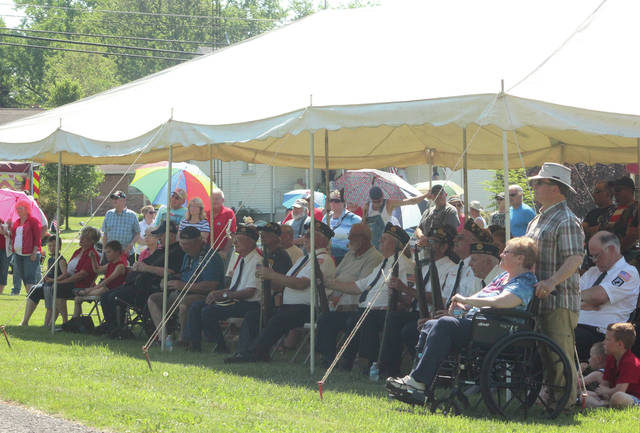 Area veterans sit under a tent during the Memorial Day ceremony in Swanton's Memorial Park.