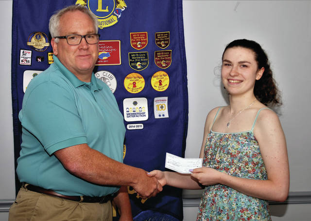 Swanton Leo Emily Hill was recently awarded a $500 scholarship from the Swanton Lions Club. Hill, pictured here with Dr. Mark Jones, will be attending Bowling Green State University and majoring in creative writing.