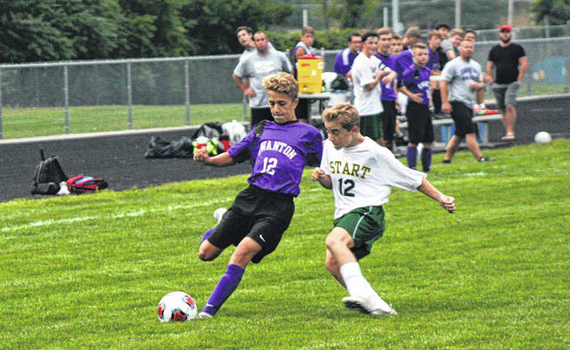 Xander Gilsdorf of Swanton, left, heads toward the net with a Start defender on him during last Monday's game. He scored the first goal of the game as the Bulldogs went on to win 3-2.