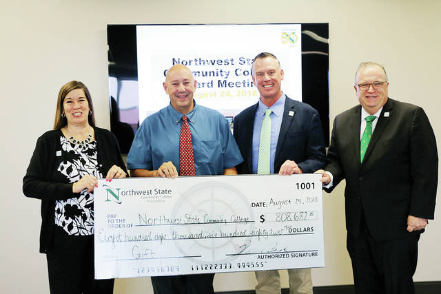 The NSCC Foundation presented the college with a record-setting check in the amount of $808,682 during the Board of Trustees meeting in Archbold. Pictured, from left, are Robbin Wilcox, Executive Director-Development and NSCC Foundation; Peter Beck, NSCC Foundation Board chairperson; Jeffrey Erb, NSCC Board of Trustees chairperson; and Dr. Michael Thomson, NSCC president.