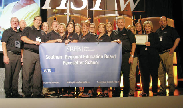 Penta staff holding the award banner at the High Schools That Work Staff Development Conference in Orlando, Fla.