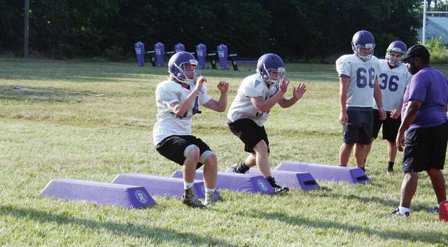 Swanton linebackers do some agility drills during practice Thursday. At the NWOAL Coaches Meeting Sunday, the Bulldogs were picked to finish sixth in the league.