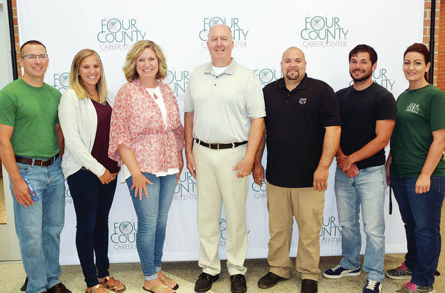 New staff members shown above are. from left, Tim Myers, Carrie Nofziger, Holli Horn, Steve Grimes, Tracy Harding, Drew Steyer, and Jenny Waldvogel.