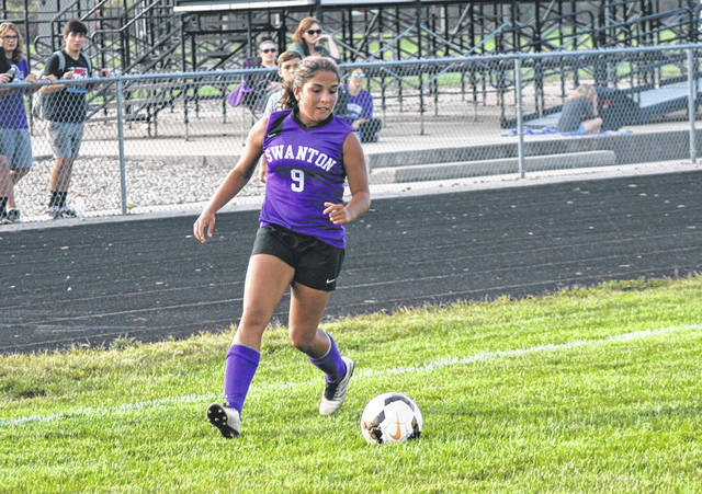 Averie Lutz of Swanton takes a ball up the right sideline Thursday versus Archbold in NWOAL play. The Bulldogs fell to the Bluestreaks, 3-0.