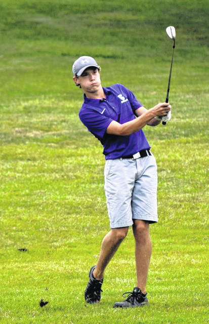 Carter Swank of Swanton with a shot during Thursday's NWOAL match at White Pines against Liberty Center. He earned medalist honors, shooting a 39.