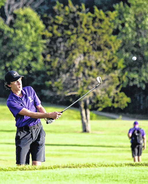 Swanton's Garrett Swank with a chip Thursday at Pike Run Golf Course in Ottawa. The Bulldogs took second to Archbold in a league tri-match that also featured host Patrick Henry.