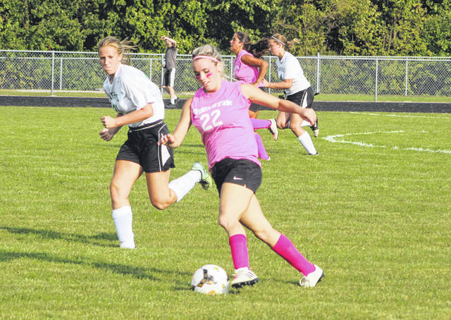 Bridget Harlett advances a ball up the field for Swanton Tuesday versus Delta. She registered two goals and an assist in the Bulldogs' 4-0 win.