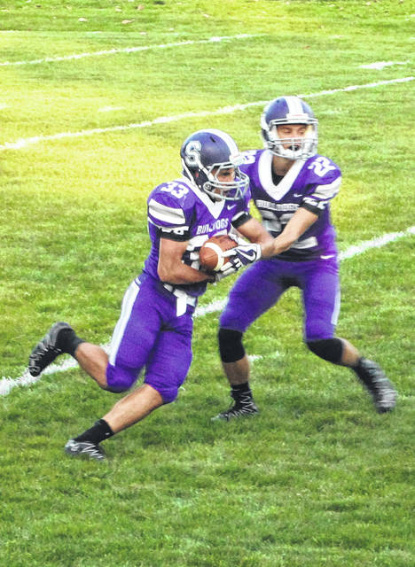 Swanton quarterback Dylan Gilsdorf hands off to Tyler Gowing during the game against Start.