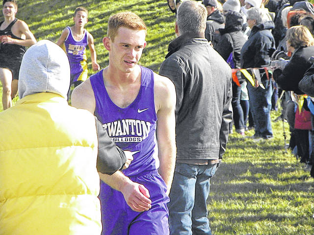 Brett Bettinger of Swanton finishes his race Saturday at the NWOAL Cross Country Championships in Archbold. He placed fifth overall, posting a time of 17:35.