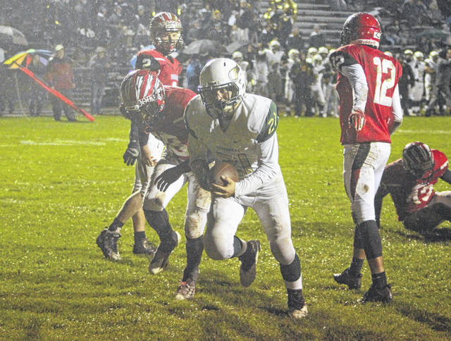 Trent Coopshaw of Evergreen bursts into the end zone for the Vikings' only score Friday at Wauseon. They fell to the Indians, 42-7.