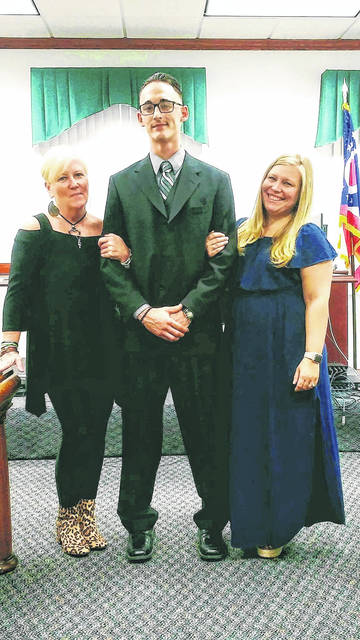 Jacob Maberson, the first Fulton County Drug Court graduate, with Carol Tiffany and Erica Burkholder, right.