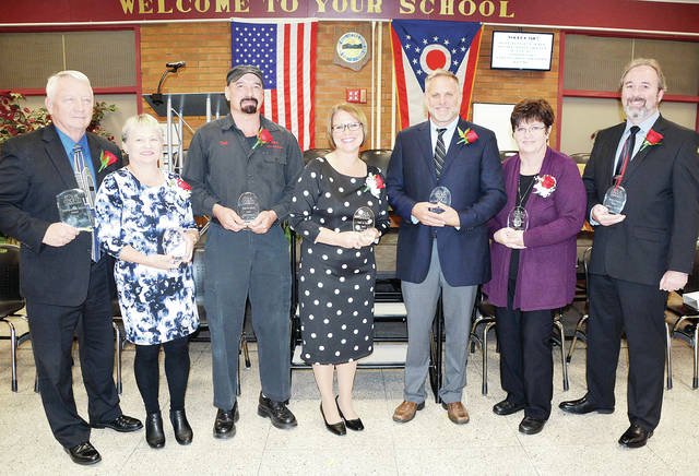 Shown holding their plaques for the Four County Career Center Wall of Fame/Distinguished Service Award are, from left, William J. Spiess, Lori Deem, Todd Henricks, Tiffany (Dennie) Kennerk, Bradley E. Mangas, Shelly Reagle, and Gregory C. VanDyke.
