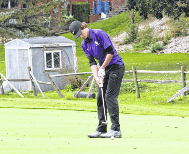 Garrett Swank of Swanton with a putt Thursday during the Division II Boys Sectional Golf Tournament at Detwiler Park in Toledo. He qualified individually as he shot an 83 to tie for 10th place.
