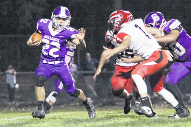 Swanton quarterback Dylan Gilsdorf looks for running room Friday versus Wauseon. He threw for 125 yards and also ran for a score.